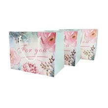 Sacos de compras de decoração Saco de presente pequeno de teste padrão de flor reciclável com alças Saco de presente de papel bonito