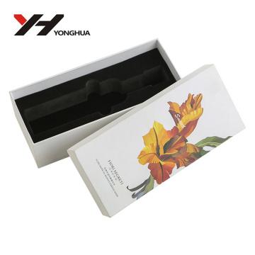 boîte en haut et en bas de papier d'art blanc de modèle de fleur jaune pour des produits de beauté