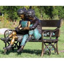 decoración de jardín al aire libre niños de metal sentado escultura de banco de bronce