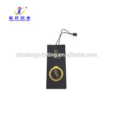 Étiquette volante de papier noir de marque de vêtements de Jean avec la conception faite sur commande