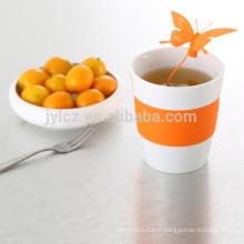 Thé en céramique 280CC vers le haut avec l'infuesr de silicone, infuseur de tasse de thé,