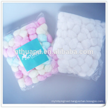 Surgical absorbent colored cotton ball