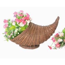 canasta de flores de cuerno de la abundancia tejiendo hojas de escoba y arista
