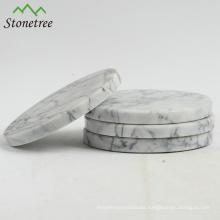 Manteles individuales de mármol de calidad superior y posavasos.