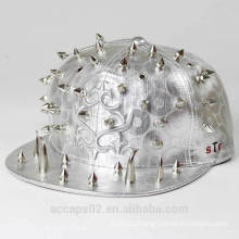 Shiny silver snapback cap with horrible studs and nail heads catches