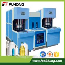Ningbo Fuhong Ce certificat 2L 5L 10L semi-automatique en plastique pour animaux de compagnie préforme soufflant moulant machine pour animaux de compagnie preofrm