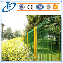 Yellow garden fence with peach shaped post