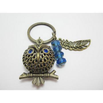 Chouette bronze avec gemme bleu yeux tons de terre trousseau