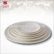 Bonne qualité os porcelaine plat porcelaine plat allant au four plateau de service rond