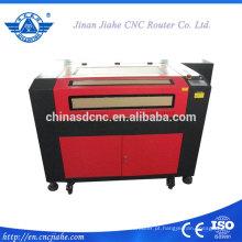 Pequeno 6090 co2 laser máquina de cinzeladura de madeira da China