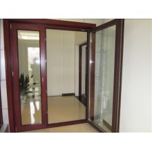 Puerta abatible de madera y aluminio