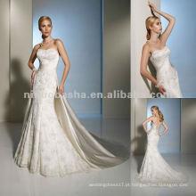 Um vestido de noiva e espreguiçadeira removível