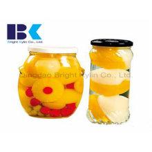 Glasflaschen von sortierten gelben Pfirsich