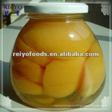 Консервированные половинки желтого персика в сиропе