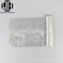 Perforated transparent plastic garbage bag on roll