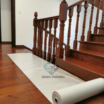 Alfombra de madera adhesiva para proteger el piso durante la construcción