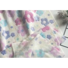 tissu tricoté en flanelle avec des fleurs jacquard
