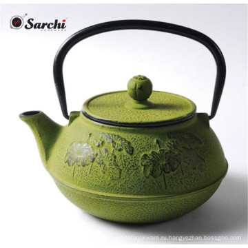 Зеленый чугунный чайник с ручкой из нержавеющей стали
