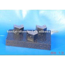 Arrow segmented wedge block for concrete grinding