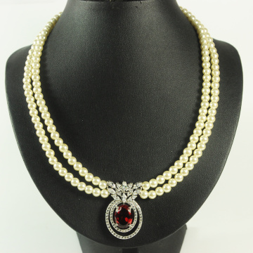 A Pearl Necklace with Red CZ Gems Pendant