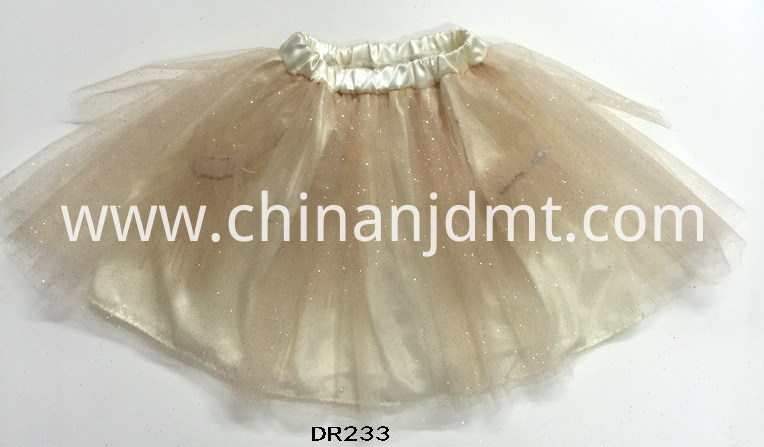 A skirt with bright gold powder