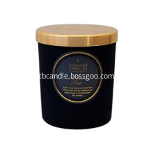 luxury soy candle in black ceramic jar with golden lid