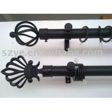 Black wrought iron curtain rod with curtain finials