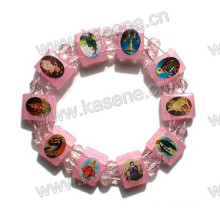 Pink Color Plastic Epoxy Saint Bracelet, Religious Bangle