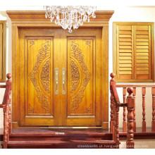 Porta dupla dourada de luxo com escultura