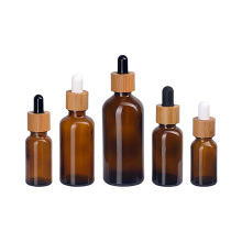 5ml 15ml 30ml 50ml 100ml amber cosmetic essential oil glass dropper bottle with bamboo lid
