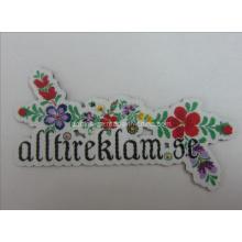 Etiquetas tejidas con forma de flor