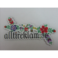 Etiquetas tecidas com forma de flor