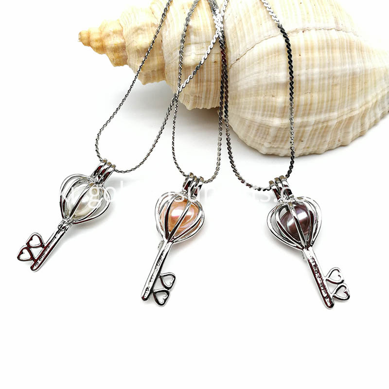 Pearl Oyster Key Shaped With Heart Cage Pendant