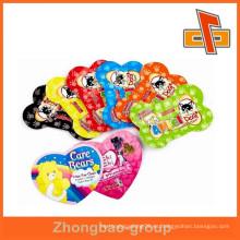 Moda a medida en forma de corazón o forma de hueso único forma bolsas para alimentos para mascotas de China fabricante