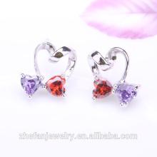 Nuevas joyas con pequeños aretes de piedra con doble corazón de cristal avenue