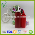 Wholesale food grade squeeze cylinder red clear ketchup packaging plastic sauce bottle with screw tip cap
