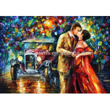 Beso entre el hombre y la mujer pintando imágenes