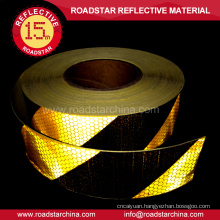 Adhesive retro reflective tape for vehicles
