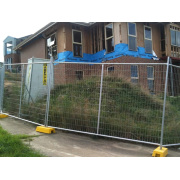 Concrete filled plastic feet temporary fence