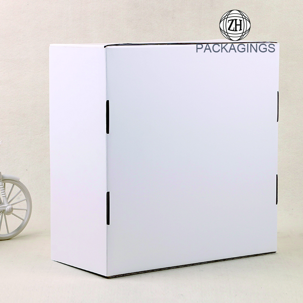 White glossy paper shipping box for clothing