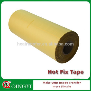 Yellow hot fix tape roll in adhesive tape