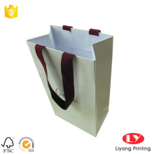 Paper gift bag with red stamp logo