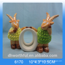 Lovely ceramic paper napkin ring with goat figurine