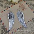 Fabricant de porcelaine, 2014 boucle d'oreille en acier inoxydable de mode avec Angel Wings, boucle d'oreille femme