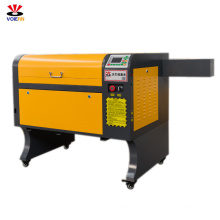 liaocheng xuanzun WER6040 aluminum Co2 desktop monogram/wood craft laser engraver engraving machine 50w60w80w100w OFF-LINE