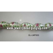 flower print and green leaf lampwork glass beads