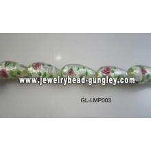 Blumen print und grünen Blatt Lampwork Perlen