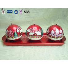Tres velas esféricas para Navidad