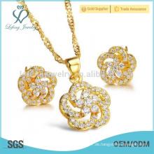 Kupferüberzug 18k Goldblumenbolzenohrringe stellten Schmucksachesatz, 18k Goldsatzschmucksachen ein