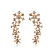 L'incrustable boucle d'oreille en or conçoit une boucle d'oreille en cristal naturel de haute qualité de 22k en or